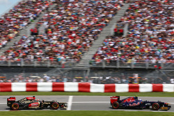 Daniel Ricciardo, Scuderia Toro Rosso STR8 leads Kimi Raikkonen, Lotus F1 E21