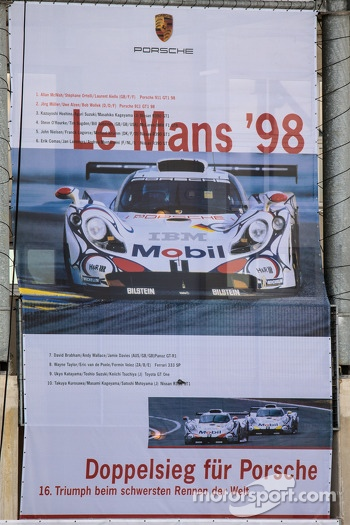 Giant advertising banners for Porsche at the back of the pit building
