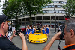 Pretty ladies being photographed at Grande Parade des Pilotes