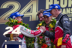 LMP1 podium: Allan McNish and Loic Duval with Dr. Wolfgang Ullrich and Ralf Jüttner