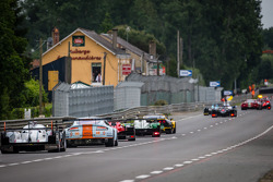 A group of cars follow the safety car during a caution