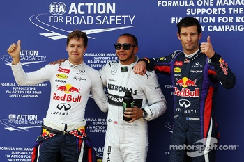 The top three qualifiers in Parc Ferme: Sebastian Vettel, Red Bull Racing, second; Lewis Hamilton, Mercedes AMG F1, pole position; Mark Webber, Red Bull Racing, third