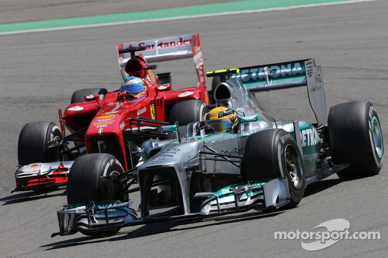 Lewis Hamilton, Mercedes Grand Prix and Fernando Alonso, Scuderia Ferrari
