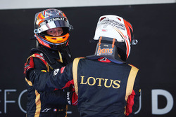 (L to R): Romain Grosjean, Lotus F1 Team and Kimi Raikkonen, Lotus F1 Team celebrate in parc ferme