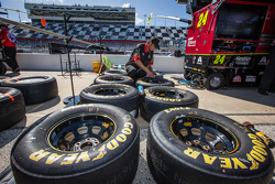 Crew member for Jeff Gordon, Hendrick Motorsports Chevrolet prepares wheels and tires