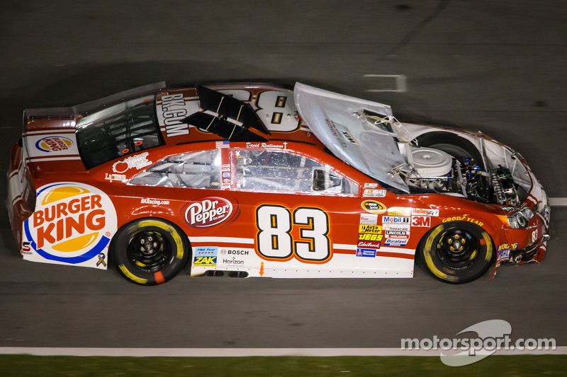 David Reutimann, BK Racing Toyota on pit road with a damaged car