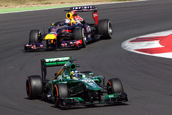Charles Pic, Caterham CT03 leads Sebastian Vettel, Red Bull Racing RB9