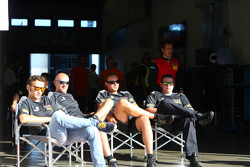Mechanics of Rowe Racing sit in their pits after their cars were withdrawn on Friday