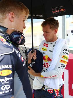 Sebastian Vettel, Red Bull Racing with Heikki Huovinen, Personal Trainer on the grid