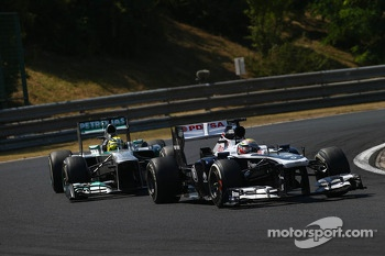 Pastor Maldonado, Williams FW35 leads Nico Rosberg, Mercedes AMG F1 W04