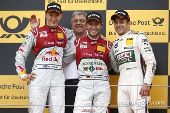 Second place Mattias Ekström, Ernst Moser, head of Audi Sport Team Phoenix, race winner Mike Rockenfeller, third place Augusto Farfus