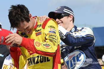 Race winner Joey Logano is congratulated by teammate Brad Keselowski
