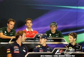 Jean-Eric Vergne, Scuderia Toro Rosso , Sebastian Vettel, Red Bull Racing and Romain Grosjean, Lotus F1 Team at the press conference.