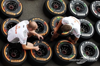 McLaren mechanics with Pirelli tyres.
