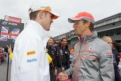Paul di Resta, Sahara Force India F1 and Jenson Button, McLaren on the drivers parade