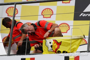 A Shell protest by Greenpeace is removed from the podium