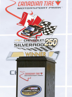 Silverado 250 trophy in victory lane