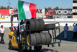 Forklift after race 2 carrying tires, an Itallian flag, and a Captain America shield