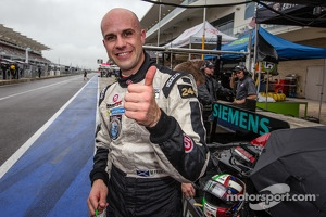 P2 pole winner Marino Franchitti celebrates