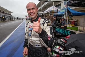 P2 pole winner Marino Franchitti celebrates