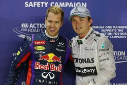 pole sitter Sebastian Vettel, Red Bull Racing with second placed Nico Rosberg, Mercedes AMG F1 in parc ferme