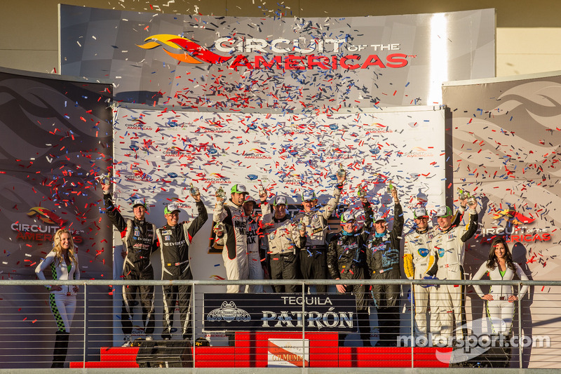 Class winners podium: PC winners Kyle Marcelli and Chris Cumming, P1 and overall winners Lucas Luhr and Klaus Graf, P2 winners Scott Tucker and Ryan Briscoe, GTC winners Ben Keating and Damien Faulkner, GT winners Jan Magnussen and Antonio Garcia