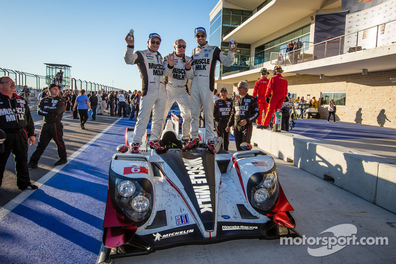 P1 and overall winners Klaus Graf and Lucas Luhr celebrate with Greg Pickett