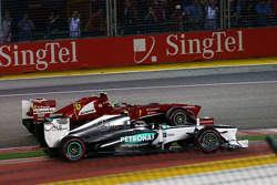 Lewis Hamilton, Mercedes AMG F1 W04 and Felipe Massa, Ferrari F138 at the start of the race