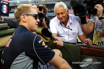 Sebastian Vettel, Red Bull Racing with Bob Constanduros, Journalist and Circuit Commentator on the drivers parade