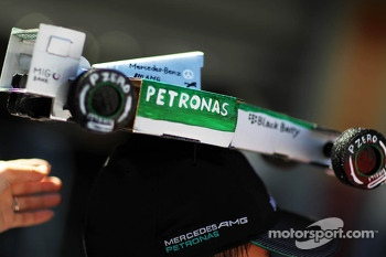 A Mercedes AMG F1 on a fans' cap
