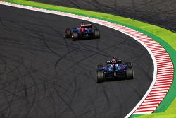 Jean-Eric Vergne, Scuderia Toro Rosso STR8 leads Mark Webber, Red Bull Racing RB9