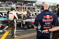 Christian Horner, Red Bull Racing Team Principal looks at the Sauber C32 of Nico Hulkenberg, Sauber on the grid
