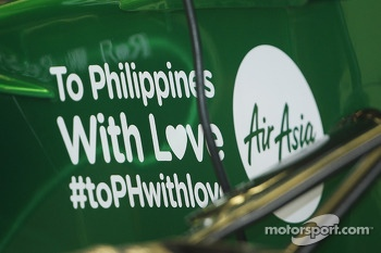 The Caterham CT03 carries a message of support to the victims of the Philippines typhoon