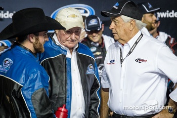 Championship victory lane: NASCAR Nationwide Series 2013 champion Austin Dillon celebrates with Richard Childress and Roger Penske