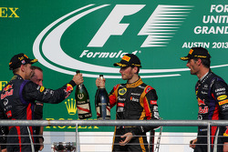 The podium, Red Bull Racing with second placed Romain Grosjean, Lotus F1 Team and third placed Mark Webber, Red Bull Racing