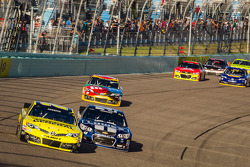 Matt Kenseth, Joe Gibbs Racing Toyota and Jimmie Johnson, Hendrick Motorsports Chevrolet battle for the lead