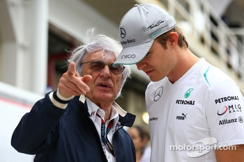 (L to R): Bernie Ecclestone, CEO Formula One Group, with Nico Rosberg, Mercedes AMG F1