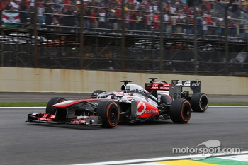 Jenson Button, McLaren MP4-28 and Nico Hulkenberg, Sauber C32 battle for position