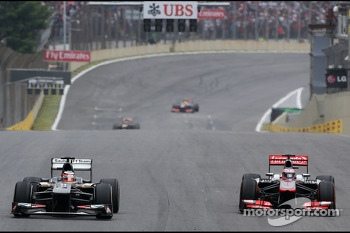 Nico Hulkenberg, Sauber F1 Team Formula One team and Jenson Button, McLaren Mercedes