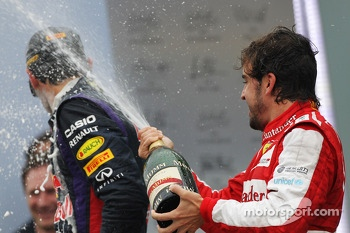 Fernando Alonso, Ferrari celebrates his third position on the podium with Mark Webber, Red Bull Racing
