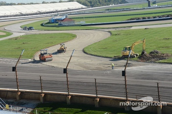 Work on repaving the infield road course continues