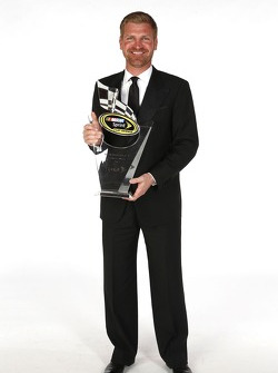 Clint Bowyer poses for a portrait with his seventh place trophy