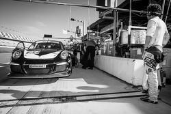 Patrick Dempsey looks on as the #27 Dempsey Racing Porsche 911 GT America: Patrick Dempsey, Joe Foster, Andrew Davis sits on pitlane