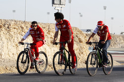 Fernando Alonso, Ferrari, on his bicycle rides the perimeter road around the circuit