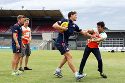 (L to R): Shaun Higgins, Western Bulldogs Australian Rules Footballer and Nico Hulkenberg, Sahara Force India F1 watch on as Will Minson, Western Bulldogs Australian Rules Footballer teaches Aussie Rules skills to Sergio Perez, Sahara Force India F1 at Wh