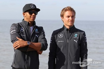 Lewis Hamilton, Mercedes AMG F1 and team mate Nico Rosberg, Mercedes AMG F1 W05 on the beach