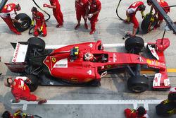 Kimi Raikkonen, Ferrari F14-T practices a pit stop