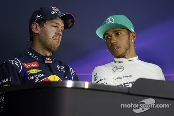 The post qualifying FIA Press Conference: Sebastian Vettel, Red Bull Racing, second; Lewis Hamilton, Mercedes AMG F1, pole position