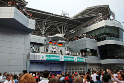 The podium, Mercedes AMG F1, second; Lewis Hamilton, Mercedes AMG F1, race winner; Sebastian Vettel, Red Bull Racing, third