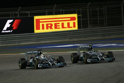 (L to R): Lewis Hamilton, Mercedes AMG F1 W05 and team mate Nico Rosberg, Mercedes AMG F1 W05 battle for position